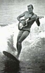 dick dale surfing with a guitar